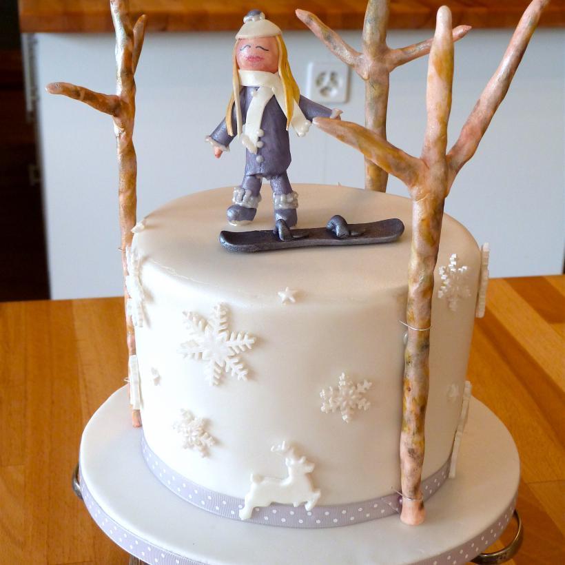 snowboarder girl cake trees snowflakes